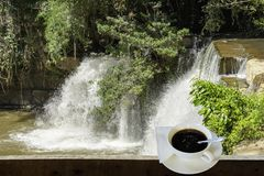 Isolated Hot coffee Put a glass of white with a casual break fro. M work background waterfall with clipping path , Thailand royalty free stock images