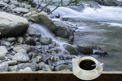 Isolated Hot coffee Put a glass of white with a casual break fro. M work background waterfall with clipping path , Thailand royalty free stock photography