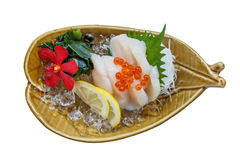 Isolated Hotate Sashimi : Raw Scallop Served with Ikura Salmon Roe with Sliced Radish and Lemon.  Stock Photography