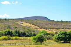 Isolated house in the backlands of Bahia in Brazil with mountains and local vegetation. Of the sertão Royalty Free Stock Photo
