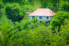Isolated house in the mountains Royalty Free Stock Photo