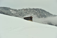Isolated house in winter time Stock Photography