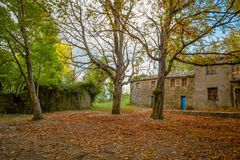 Isolated house in the woods in autumn, Italy royalty free stock images