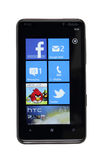 Isolated HTC HD7 running Windows Phone 7. HTC HD7 running windows phone 7 operating system Royalty Free Stock Images