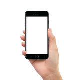 Isolated human hand holding black mobile smart phone mockup. On white background Stock Photography