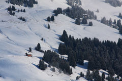 Isolated hut on a snow covered mountainside. Isolated hut on a snow covered Swiss mountainside Royalty Free Stock Photo