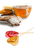 Isolated image of cup of tea, candy and cookies on white background closeup Royalty Free Stock Photography