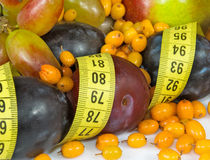 Isolated image of fruits and centimeters close-up Royalty Free Stock Photos