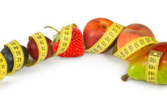 Isolated image of fruits and centimeters closeup Royalty Free Stock Photo