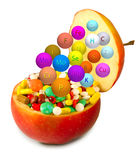Isolated image of pills inside apples closeup Stock Photos