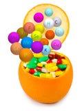 Isolated image of pills inside orange close-up Royalty Free Stock Photos