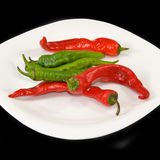 Isolated image of red hot pepper on plate close-up Royalty Free Stock Images