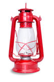 Isolated image of red kerosene lantern with glass. Chamber and metal frame against a white background royalty free stock images