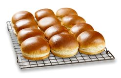 Brioch buns cooling on a wire tray royalty free stock photo