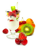 Isolated image of yogurt in a glass with fruit on a white background close up Royalty Free Stock Photography