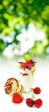 Isolated image of yogurt in a glass with fruit on a white background close up Royalty Free Stock Image