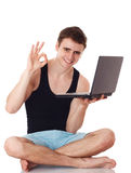 Isolated image of a young man with his laptop. Royalty Free Stock Photography