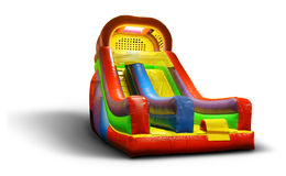 Isolated Inflatable Slide. Isolated shot of a bounce house inflatable playground slide royalty free stock photo
