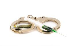 Injection shot with money on the handcuffs Isolate. Isolated injection shot with money on the handcuffs over white background royalty free stock photos