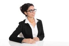 Isolated intelligent academic looking sideways on white backgrou Royalty Free Stock Images