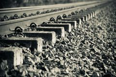Isolated iron made railway tracks unique black and white photo. Isolated iron made railway tracks with stones unique black and white photo stock photography