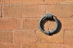 Isolated iron ring on the brick wall Stock Photos