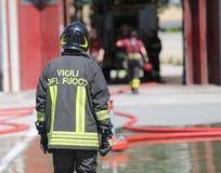 Isolated Italian fireman with protective uniform Stock Photo