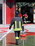 Isolated Italian fireman with protective uniform and helmet Royalty Free Stock Photography