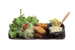 Isolated Japanese tempura mussel is deep fried mussel mixing with flour served with egg salad. Isolated Japanese tempura mussel is deep fried mussel mixing with Stock Image