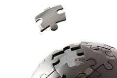 Isolated jigsaw globe. Puzzle globe with floating piece stock photo