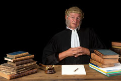 Isolated judge. Mature judge with wig and gavel isolated against a black background royalty free stock photography