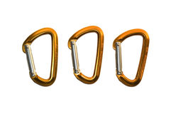 Isolated karabiners. Three isolated orange and silver karabiners/carabiners on white background Stock Photos