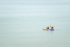 Isolated kayak paddlers on a big, calm sea. Royalty Free Stock Image