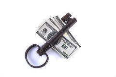 Isolated key and money Royalty Free Stock Photo