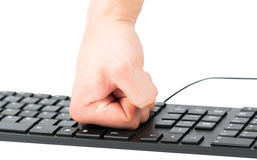 Isolated keyboard and fist Royalty Free Stock Image
