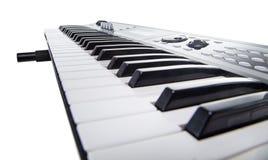 Isolated keyboard of synthesizer. On white background Stock Image