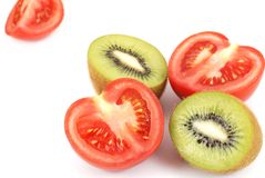 Isolated kiwi and tomato Stock Images