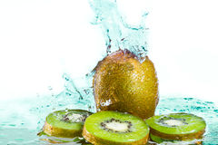 Isolated Kiwi with water splash Stock Photos