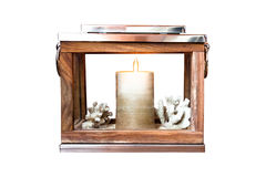 Isolated lantern with candle. Nautical antique wooden lantern with metal cover and candle inside stock photo