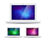 Isolated laptops and abstract colorful backgrounds. Blue, green, purple Stock Images