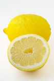 Isolated lemon and a half Royalty Free Stock Images