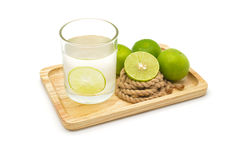 Isolated lemonade with fresh green lemons Royalty Free Stock Image
