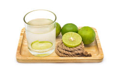 Isolated lemonade with fresh green lemons Stock Photography