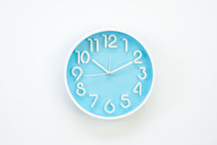 Isolated light blue background alarm clock with whte body and wh Stock Photo
