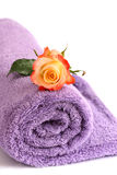 Isolated lilac towel with yellow rose Royalty Free Stock Photography