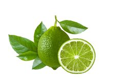 Whole lime fruit and slice circle with fresh leaves isolated on white background, close up Stock Photos