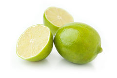Isolated Lime and Slices on White Background stock photos
