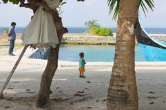 Isolated little boy in the harbor with his father royalty free stock photography