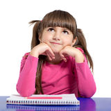 Isolated little girl sitting at the table and draws Royalty Free Stock Photos