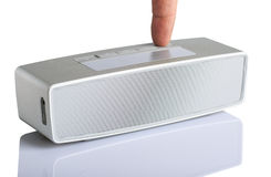 Isolated little  portable grey speaker Royalty Free Stock Image